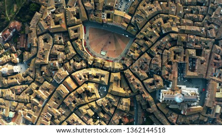 Aerial top-down view of Siena involving Piazza del Campo or Campo Square, a place of famous horse-race, Palio di Siena. Italy #1362144518
