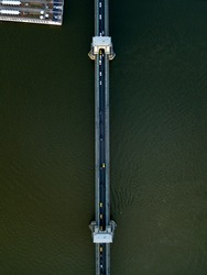 Aerial top down view of Széchenyi Chain Bridge road over dark water of river Danube in Budapest city. Cars going on road. Traffic. Hungary.