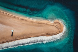 Aerial top-down view of the  Golden Horn, an amazing beach located 2 kilometres west from the harbour town of Bol on the southern coast of the Croatia