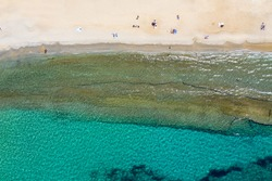 Aerial top down view of the Megali Ammos beach on Mykonos island, Cyclades, Greece