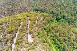 Aerial top down view over Galstone road crossing Berowra creek in Hornsby and Berowra heights of Greater Sydney, Australia.