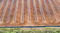 Aerial top-down view to the drainage ditches and horticultural peat extraction field. Peat extraction from natural bogs have severe impact to water protection, biodiversity and climate change issues