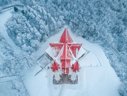 Aerial top point of view of the famous landmark of Ufa city and Bashkortostan - Lala Tulip mosque during sunset in winter season. Islamic religion and muslim culture in Russia concept