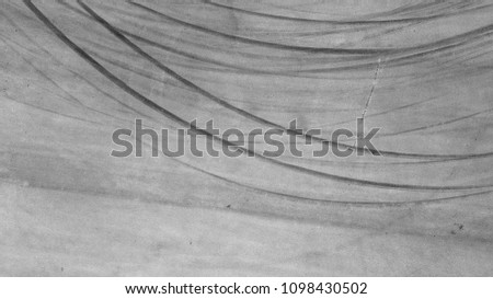 Aerial top view background with skid marks on race track.