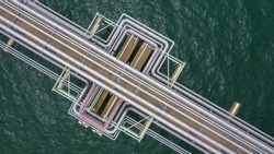Aerial top view commercial gas and oil pipe line chemical in the ocean from drill or drilling crude oil and gas, Power and Energy background concept.