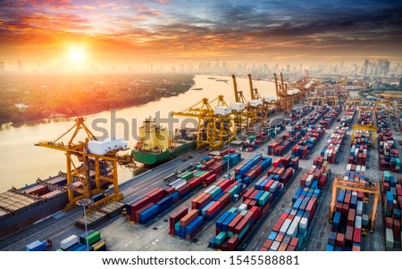 Aerial top view container cargo ship in import - export business logistic and transportation of Container Cargo ship with working crane bridge in shipping