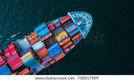 Aerial top view container cargo ship in import export business logistic and transportation of international by container cargo ship in the open sea, with copy space. - Shutterstock ID 708817909
