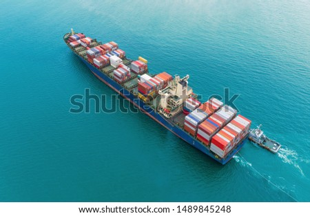 Aerial top view container ship for logistics, import export, shipping or transportation.