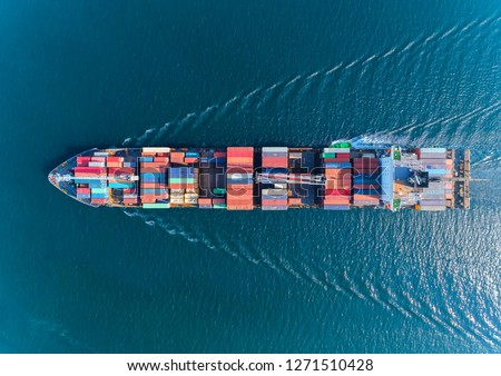 Aerial top view container ship with crane bridge for load container, logistics import export, shipping or transportation concept background.