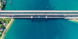 Aerial top view drone shot of bridge with cars on bridge road image transportation background concept.