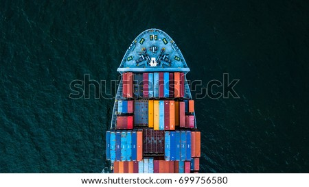 Aerial top view from drone, container cargo ship in import export and business logistic and transportation of international by container ship in the open sea, with copy space.