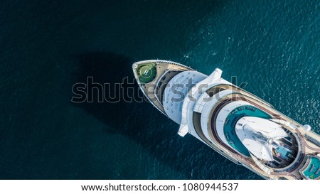 Aerial top view large cruise ship at sea, Passenger cruise ship vessel sailing across the Gulf of Thailand.