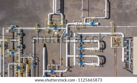 Aerial top view natural gas pipeline, gas industry factory, Business gas transport system, stop valves and appliances for gas pumping station.