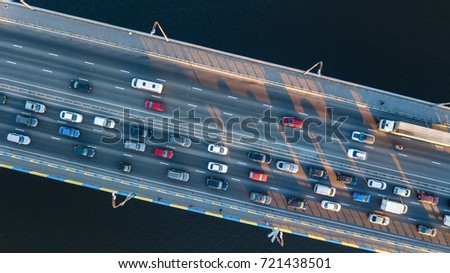 Aerial top view of bridge road automobile traffic jam of many cars from above, city transportation concept  #721438501