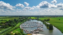 Aerial top view of camping and marina with boats in harbour from above, North Holland, Netherlands