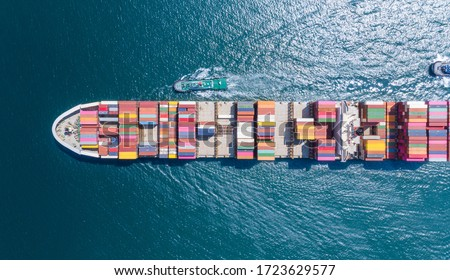Aerial top view of cargo ship carrying container and running for export  goods  from  cargo yard port to custom ocean concept freight shipping by ship .