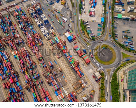 Aerial top view of container cargo ship in the export and import business and logistics international goods in urban city. Shipping to the harbor by crane in Victoria Harbour, Hong Kong. #1373161475