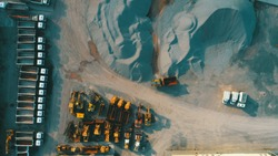 Aerial top view of crushed stone quarry machine in a construction material factory