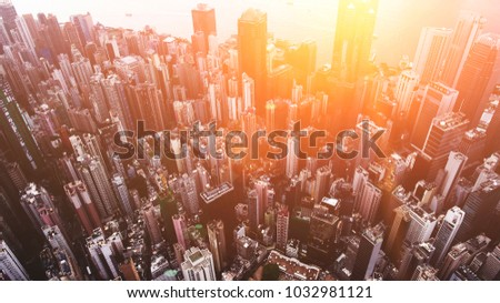 Aerial top view of developed Metropolis city with tall office skyscrapers in downtown district with blocks. Big megapolis cityscape with advanced urbanisation and infrastructure. Real estate business #1032981121