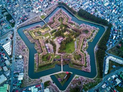 Aerial Top view of Fort Goryokaku with cherry blossom, Build for protect city from enemy in  Star Shape. This place is a famous to visit in Hakodate, Hokkaido Japan