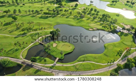 Aerial top view of green grass and trees on a golf field, fairway and putting green top view, Bangkok Thailand. bird view over Golf course in the tropical Bangkok.