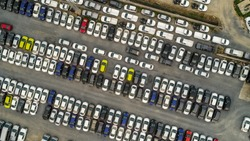 Aerial Top view of new cars lined up at Industrial factory Port, Logistics import - export and transportation concept
