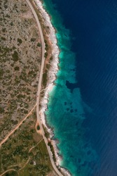 Aerial top view of the coastline road.