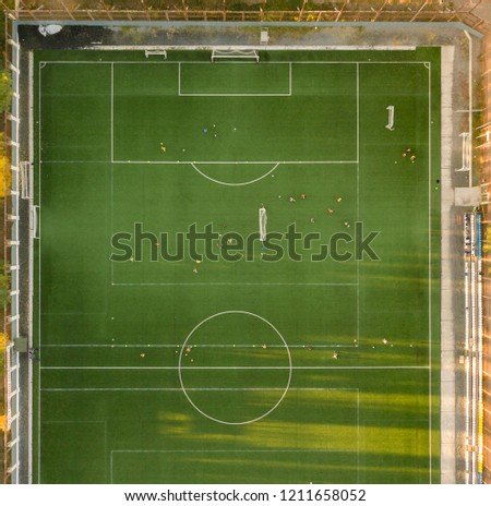 aerial top view of the football soccer field with players practice