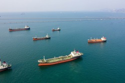 Aerial top view of the ship carrying the lpg and oil tanker in the sea port. For energy export and import business for transportation