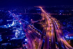 Aerial top view of transportation with Expressway, Road and Roundabout, multilevel junction traffic highway-Top view. Important infrastructure and transport in big city, Bangkok Thailand.