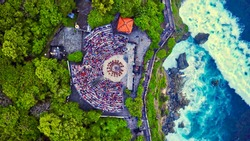 Aerial top view of Uluwatu temple's arena during the sunset ceremony Kecak dance in Bali, Indonesia