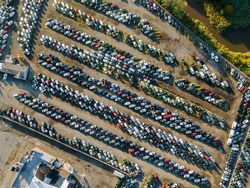 Aerial top view of used car auction for sale a parking lot business logistics