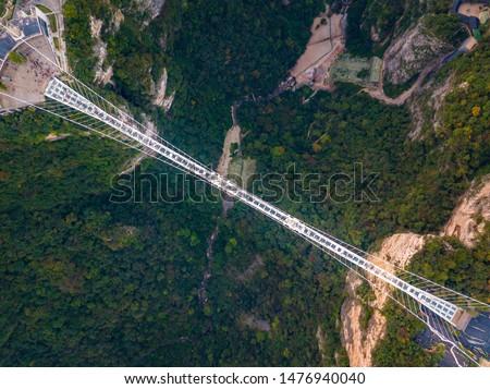 Aerial Top View of Zhangjiajie Grand Canyon and Glass Bridge on sky, China #1476940040