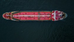 Aerial top view oil tanker logistic and transportation in the open sea.