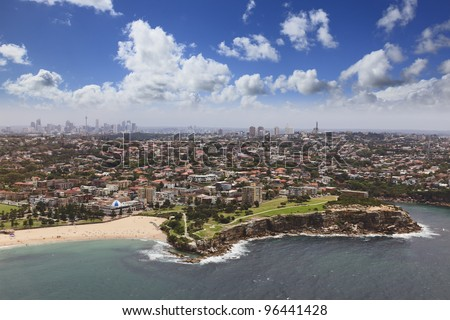 Aerial top view on Sydney CBD, suburbs and bondi beach with cliff coastline from helicopter flight around Australia landmarks