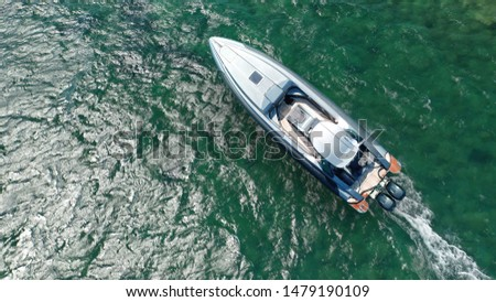 Aerial top view photo of luxury inflatable rib speed boat cruising in open ocean sea #1479190109