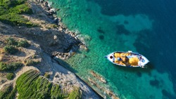 Aerial top view photo of traditional fishing boat in island of Skiathos, Sporades, Greece