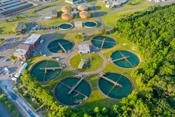Aerial top view recirculation sedimentation tank, water treatment plant for big city from water management