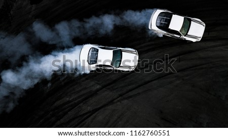 Aerial top view two cars drifting battle on race track, Two cars battle drift, Race cars view from above.