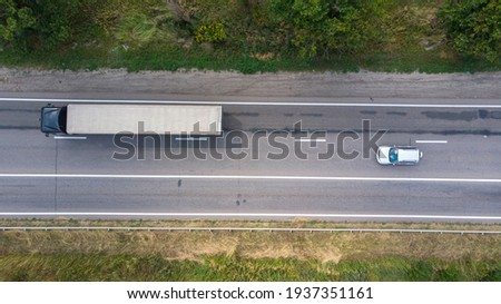 Aerial. Traffic by the rural highway. Sedan car and truck on the motorway. Top view from drone.  Stock photo ©