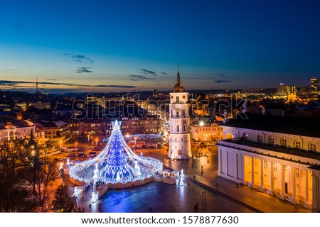 Aerial twilight view of Vilnius cathedral square with main Christmas tree decorated for New Year and Christmas celebrations