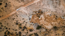 Aerial veiw of four wheel drive vehicle and large caravan on an outback road in Australia.