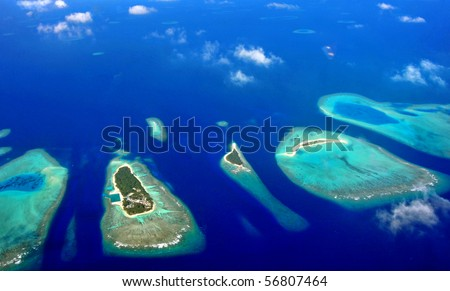 aerial view above maldives , atolls