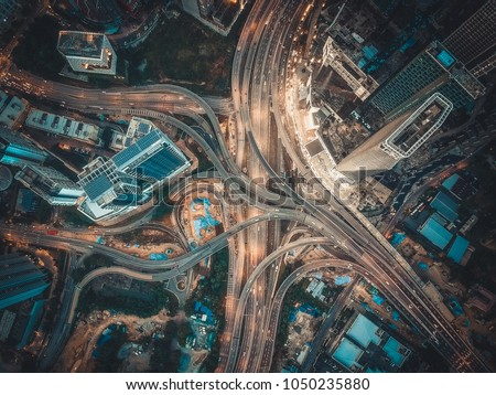 Aerial View Above of Busy Highway Intersection Road Junctions at morning. The image contain soft focus, grain and noise. #1050235880