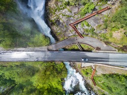 Aerial view af small bridge over waterfall in Norway