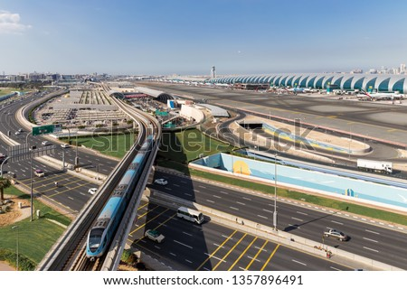 Aerial View.Airport Terminal with Airplanes Taxiing and Landing.In Dubai International Airport
