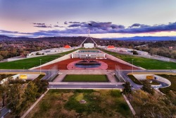 Aerial view around Capitol hill in Canberra - Australian Capital Territory. Facade of public government building with square and surrounding park lands.