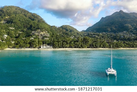 Aerial view at beautiful Beau Vallon beach, bay on the north western coast of Mahé in the Seychelles. Tropical landscape with yacht Photo stock ©