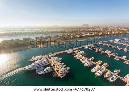 Aerial view at Dubai Palm Jumeirah. Sea harbor with villas and yachts. #477698287