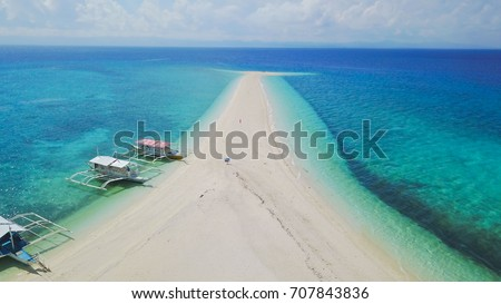 Aerial view at Kalanggaman Island sandbar at Malapascua Island, Cebu, Philippines showing crystal clear blue sea water in sunny day - Shutterstock ID 707843836